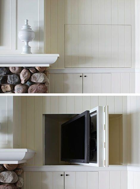 Tv escondida en la pared